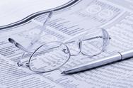 Stock Photo of newspaper with glasses and pen