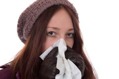Young woman with a cold and flu virus sneezing Stock Photos