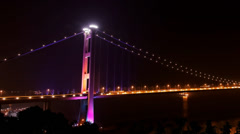 Tsing Ma Bridge in Hong Kong at night Stock Footage