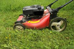 lawn mower cutting grass - stock photo