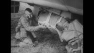 Stock Video Footage of WW2-USairforce-Parachutist26-LoadMaterialRust