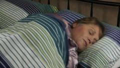 Sleeping Woman Turns Stock Footage