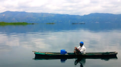 Fisherman in a small boat with his trap Stock Footage