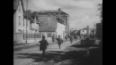 Stock Video Footage of WW2 - US air Force - Paratroopers 27 - Forces in french Village