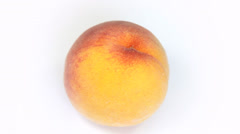 Ripe  peach fruit rotating on white background Stock Footage