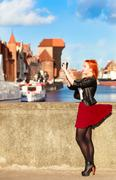 Traveler woman red hair girl with camera old town gdansk Stock Photos