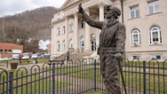 Stock Video Footage of Person Climbs Steps of Boone County Courthouse in Background of Statue Honoring