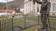 Stock Video Footage of Man and Woman Descend Steps of Boon Country Courthouse in Background of Statue