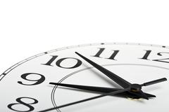 White clock showing time about nine isolated Stock Photos