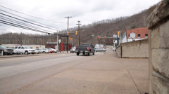 Traffic at a Stop Light in Front of Madison Fire Department in Madison, WV Stock Footage