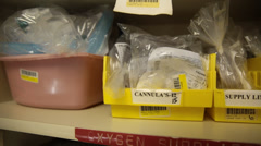 Pan of Shelf of Oxygen Supplies in Hospital Supply Room Stock Footage