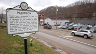 Stock Video Footage of Truck Passes in Front of Boone Country Courthouse and Madison Historical Marker