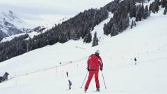 People skiing down, Alps, Austria HD Stock Footage