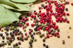 Dry bay laurel leaf with multicolored peppercorn Stock Photos