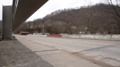 POV of Vehicles Passing Over Bridge in Appalachian Mountain Region Stock Footage