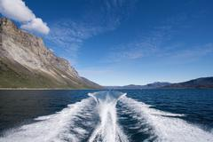 Stern wave from boat - stock photo