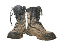 Dirty boots Stock Photos