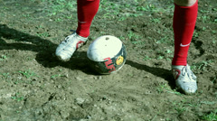 Football player on a muddy pitch Stock Footage