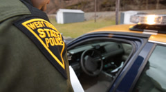 Closeup on West Virginia State Trooper and Uniform Shoulder Patch Stock Footage
