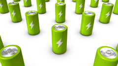 High angle arc pull back revealing endless Batteries (Green) Stock Footage