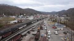 Tilt Shot of Rail Yard With Empty Coal Railcars. Stock Footage