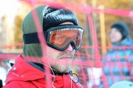 Stock Photo of portrait of a snowboarder in glasses