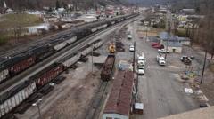 Tilt Shot of Rail Yard With Empty Coal Railcars. - stock footage