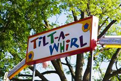 colorful tilt a whirl sign - stock photo