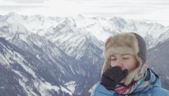 Young woman coughing in winter mountains HD Stock Footage