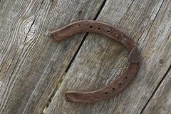 Old rusty horse shoe Stock Photos