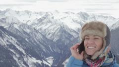 Attractive woman talking on cellphone in the mountains, Alps, Austria  HD Stock Footage