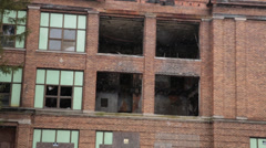 Pan Shot of Closed, Abandoned Factory Stock Footage