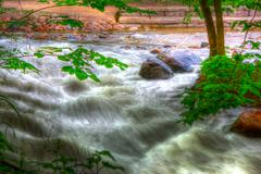 rocky river rapids in hdr - stock photo