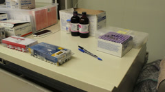 Veterinary supplies including vaccines on a table, panning shot. Stock Footage