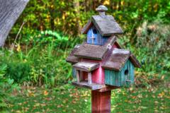 large wooden bird house on a 4x4 in high dynamic range - stock photo
