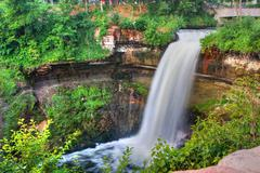 peaceful waterfall in high dynamic range - stock photo