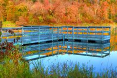 high dynamic range of a boat dock and fall colors - stock photo