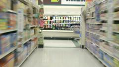 Shopping cart racing through grocery aisles in time lapse Stock Footage