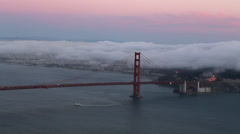 Sunset View of the Golden Gate Bridge from the Peak of Hawk Hill - stock footage