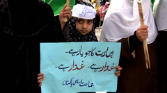Cute Girl in a Scarf Holds a Poster at an Islamist Rally Stock Footage