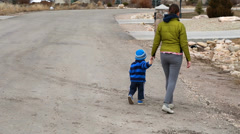 A mother and toddler going on walk Stock Footage