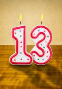 burning birthday candles number 13 - stock photo