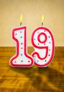 Burning birthday candles number 19 Stock Photos