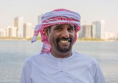 Portrait of an unknown arab men on the waterfront in sharjah, uae Stock Photos