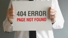 Businessman holding paper with 404 Error - Page not found title. Stock Footage