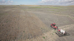 AERIAL - Planting No Till Wheat into CRP Field Stock Footage