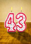 burning birthday candles number 43 - stock photo
