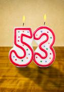 burning birthday candles number 53 - stock photo