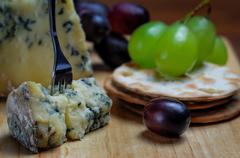Roquefort blue cheese with grapes and crackers Stock Photos