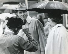Queen Elizabeth at races - stock photo
